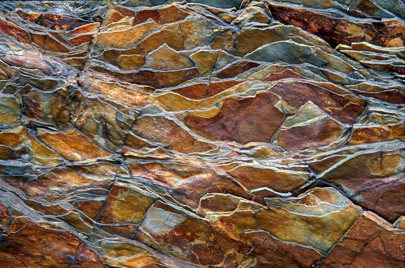 Billion-year-old rock breaks into a jagged pattern in Glacier National Park, Montana.